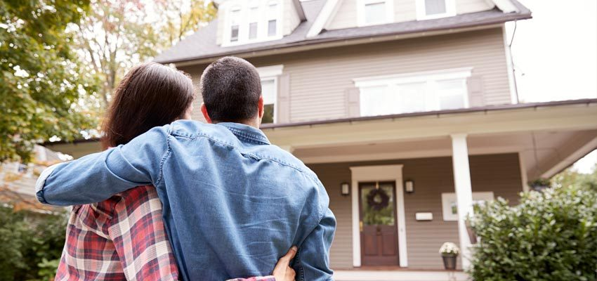 Couple looking at their newly purchased home